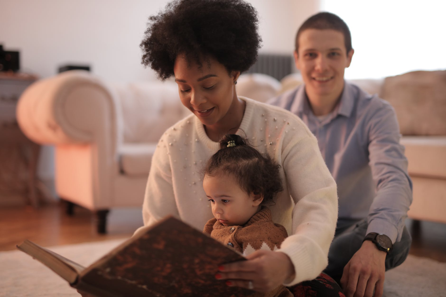 photo of woman reading a story to her child