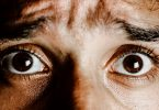 brown eyes of scared young person