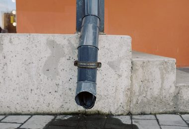 black pipe on concrete wall