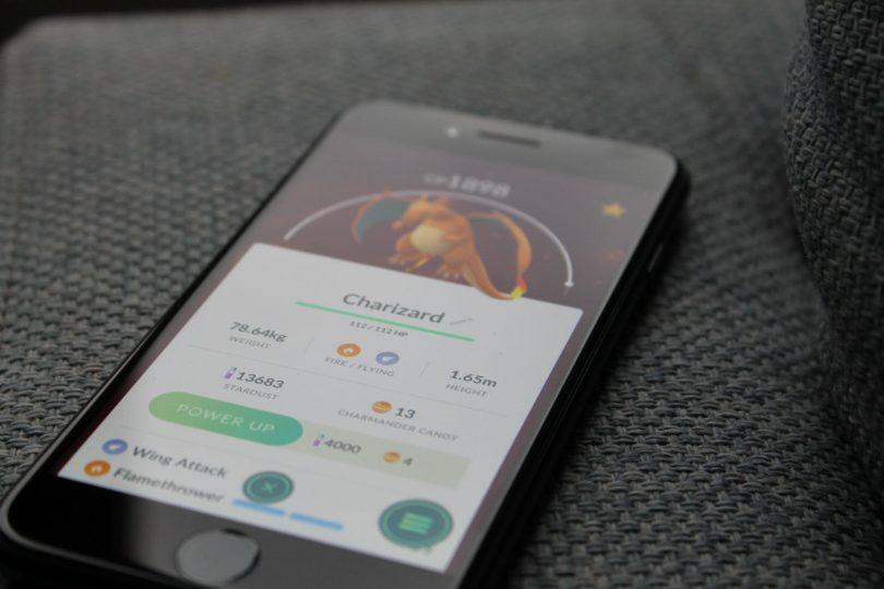 turned on iphone displaying pokemon go charizard application